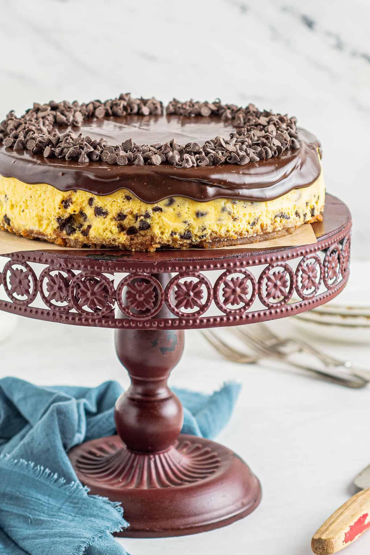 chocolate chip cheesecake on cake stand