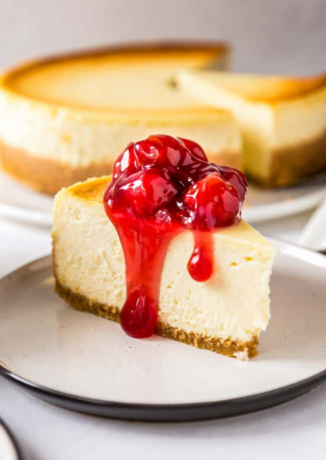 new york cheesecake topped with cherries