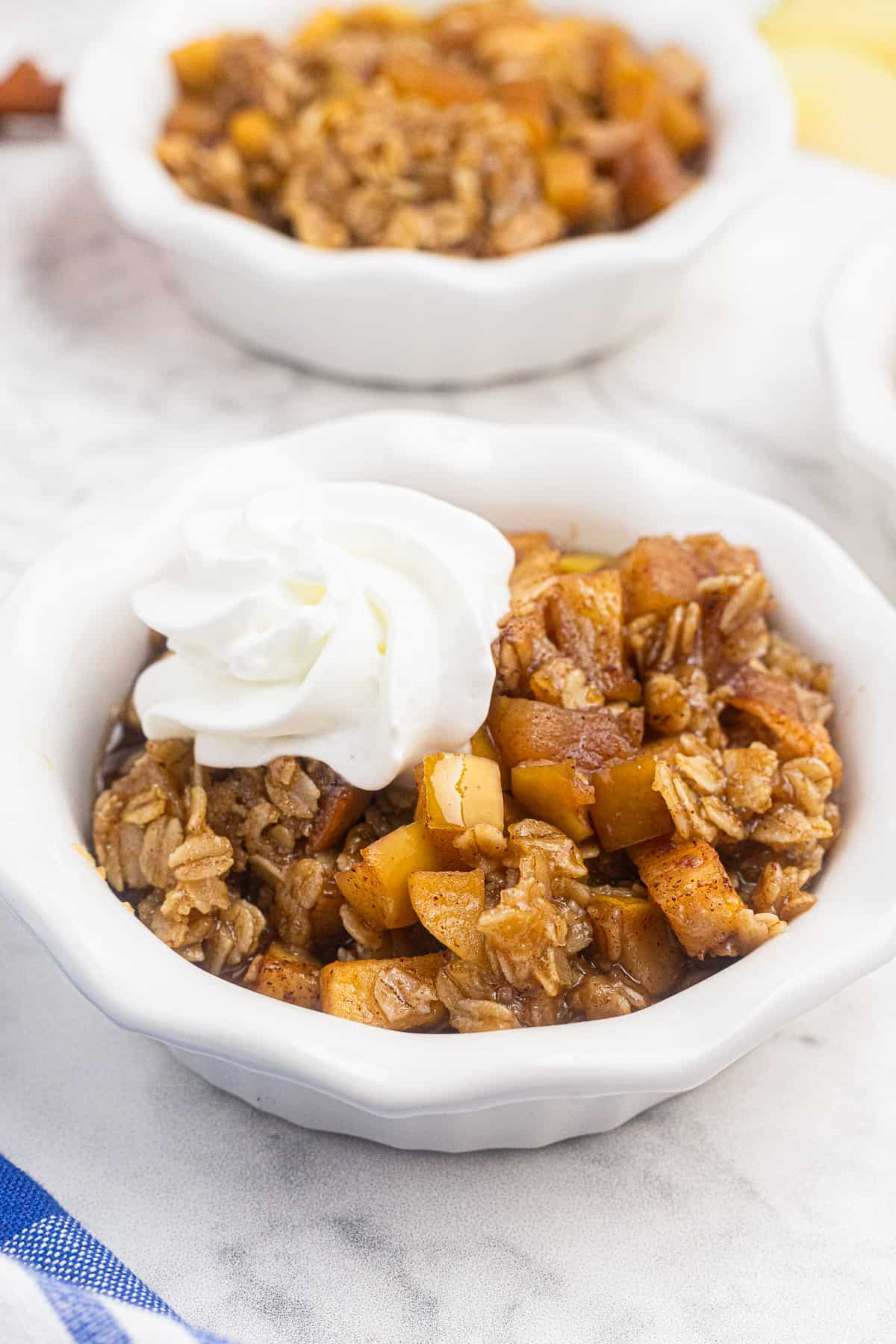 bowl of instant pot apple crisp with whipped cream