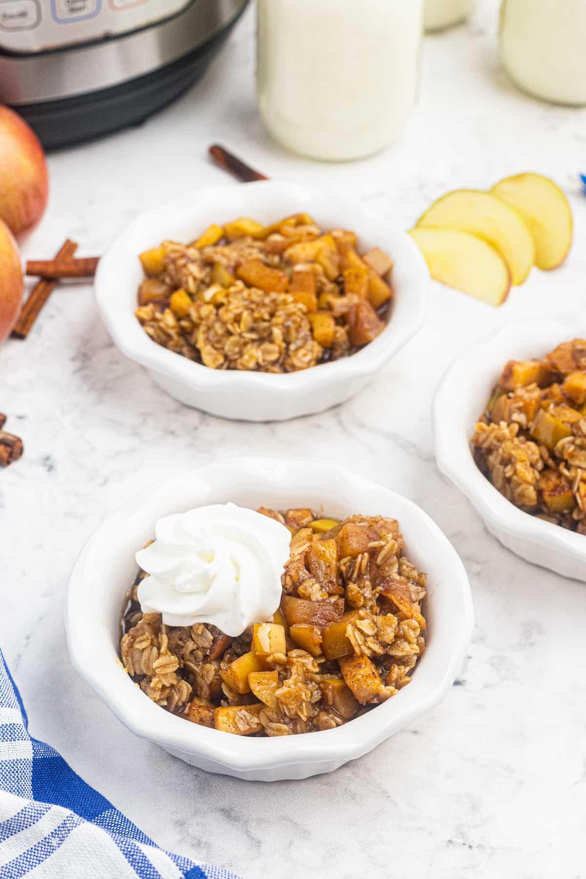 instant pot apple crisp in white bowls