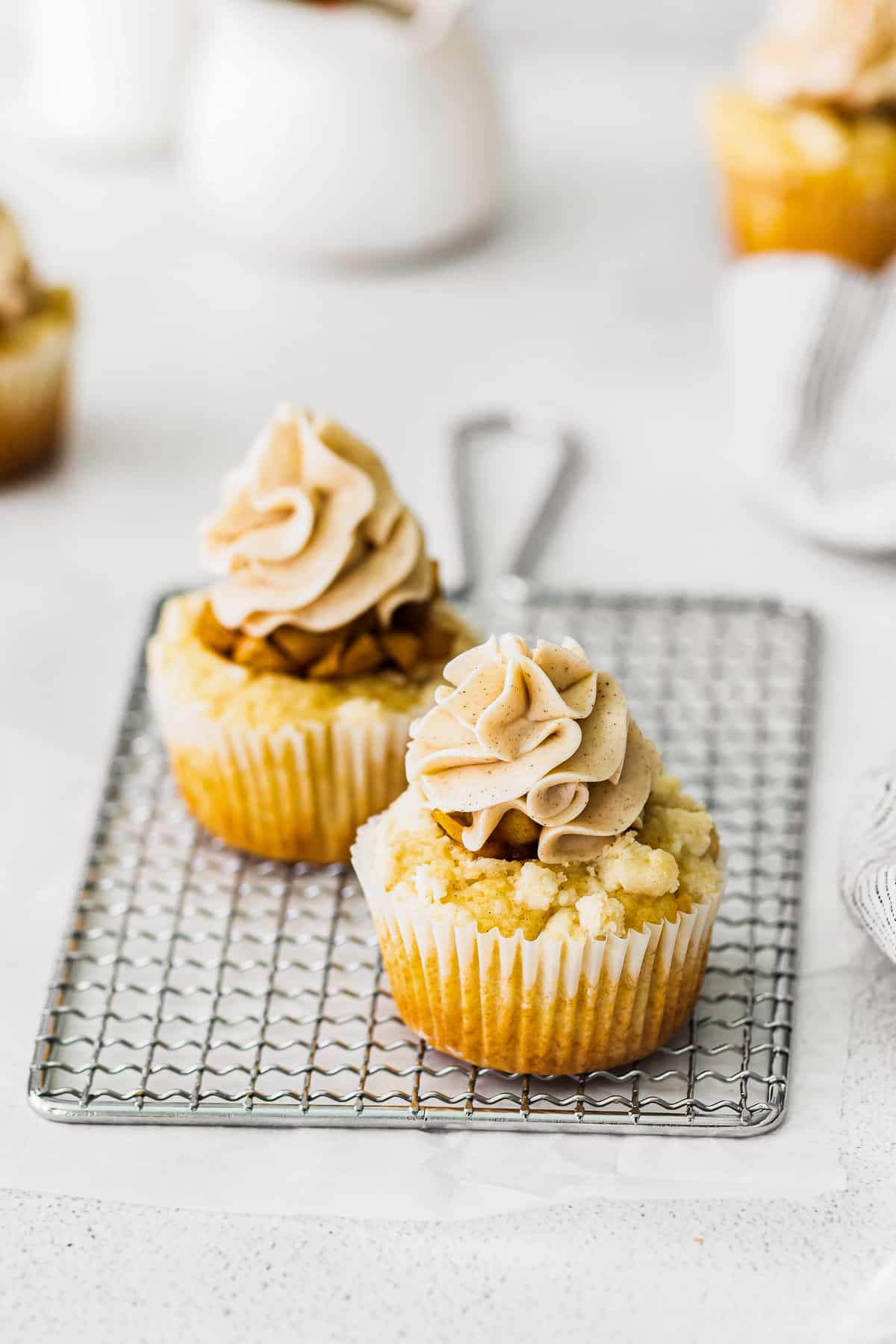 apple pie cupcakes on cooling rack