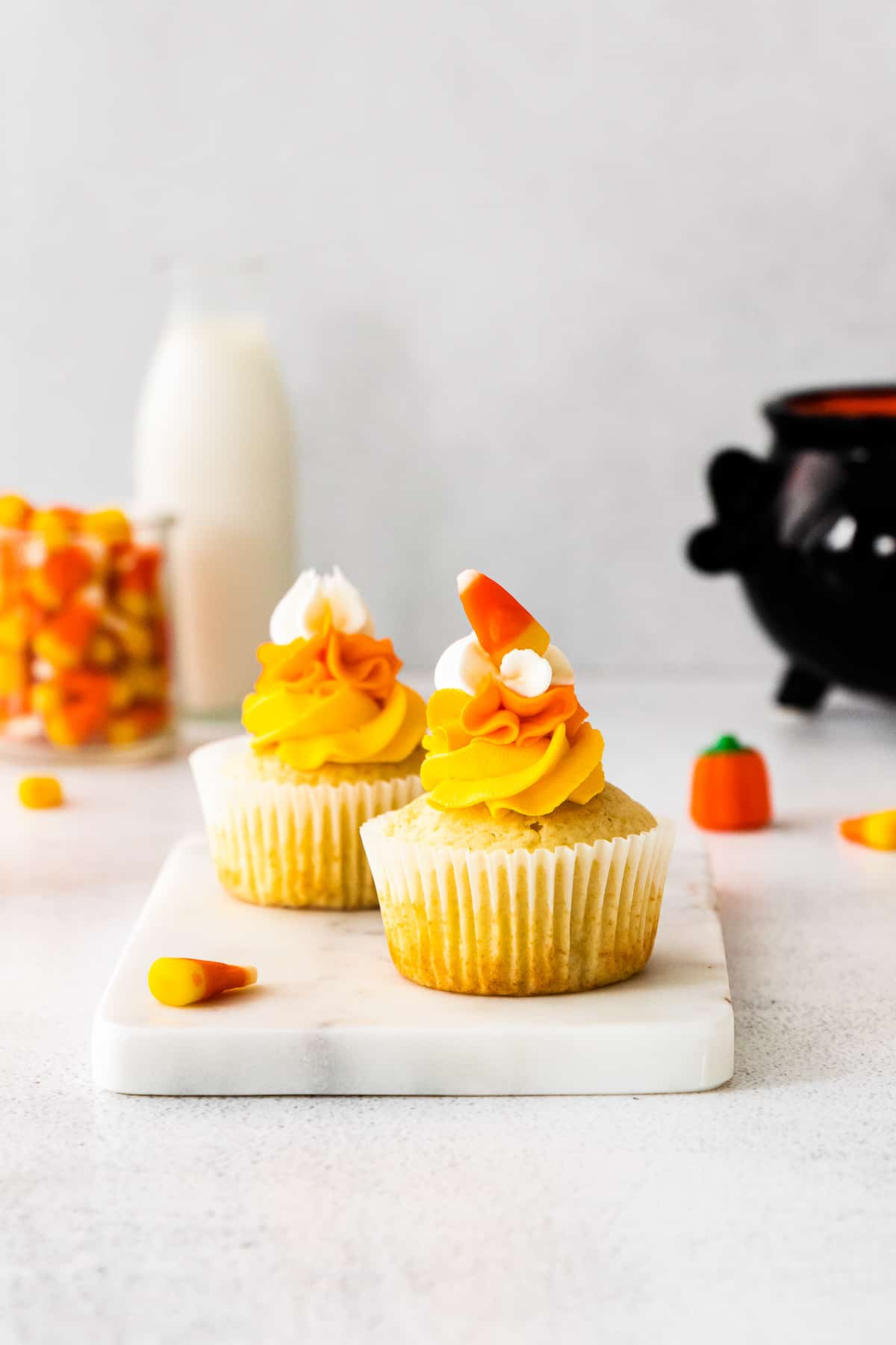 candy corn cupcakes on marble tray