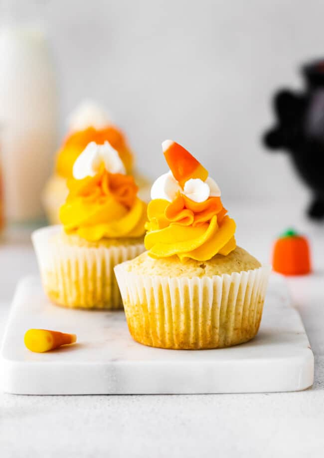 up close candy corn cupcakes on marble tray