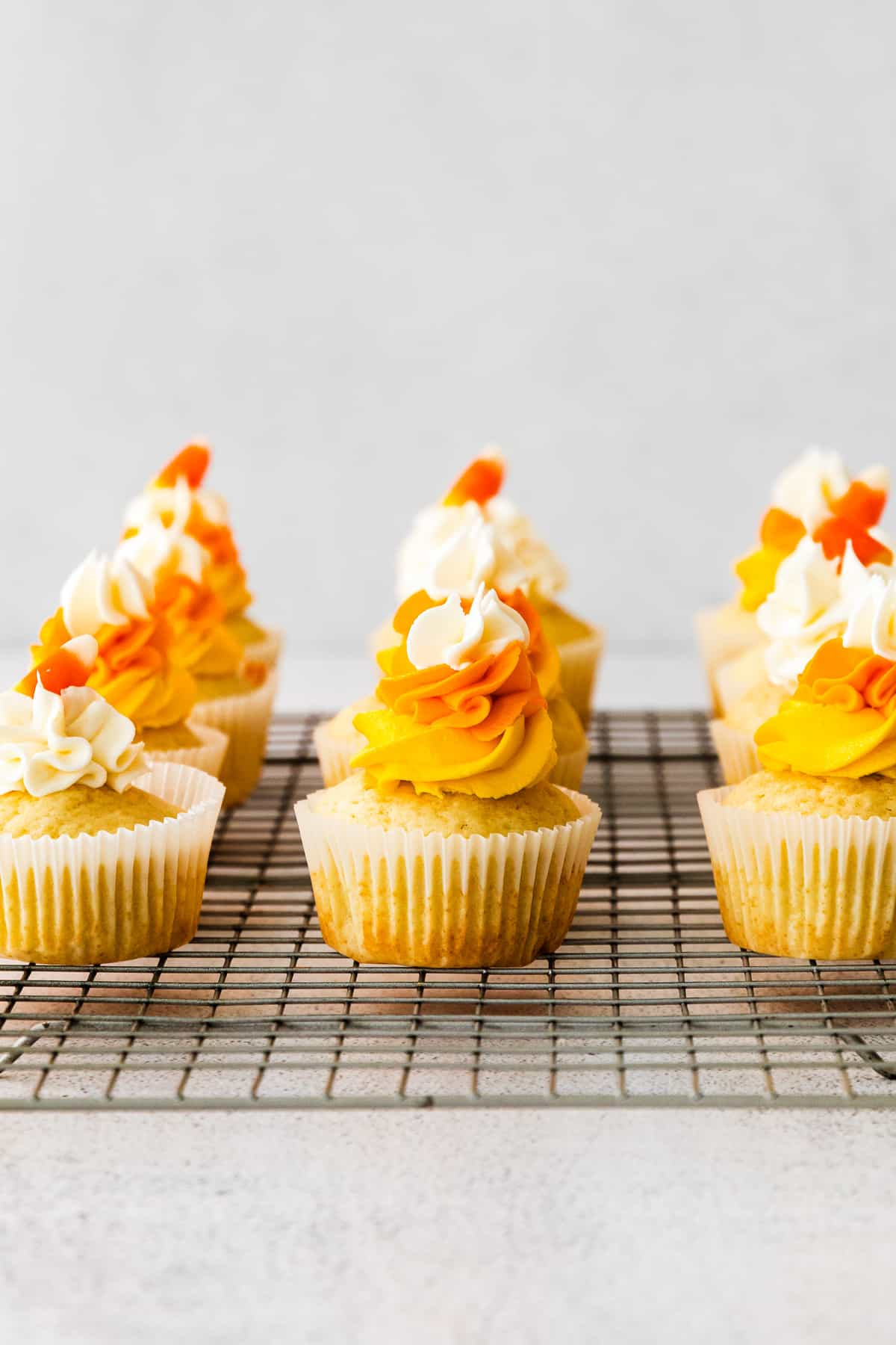 candy corn cupcakes on cooling rack