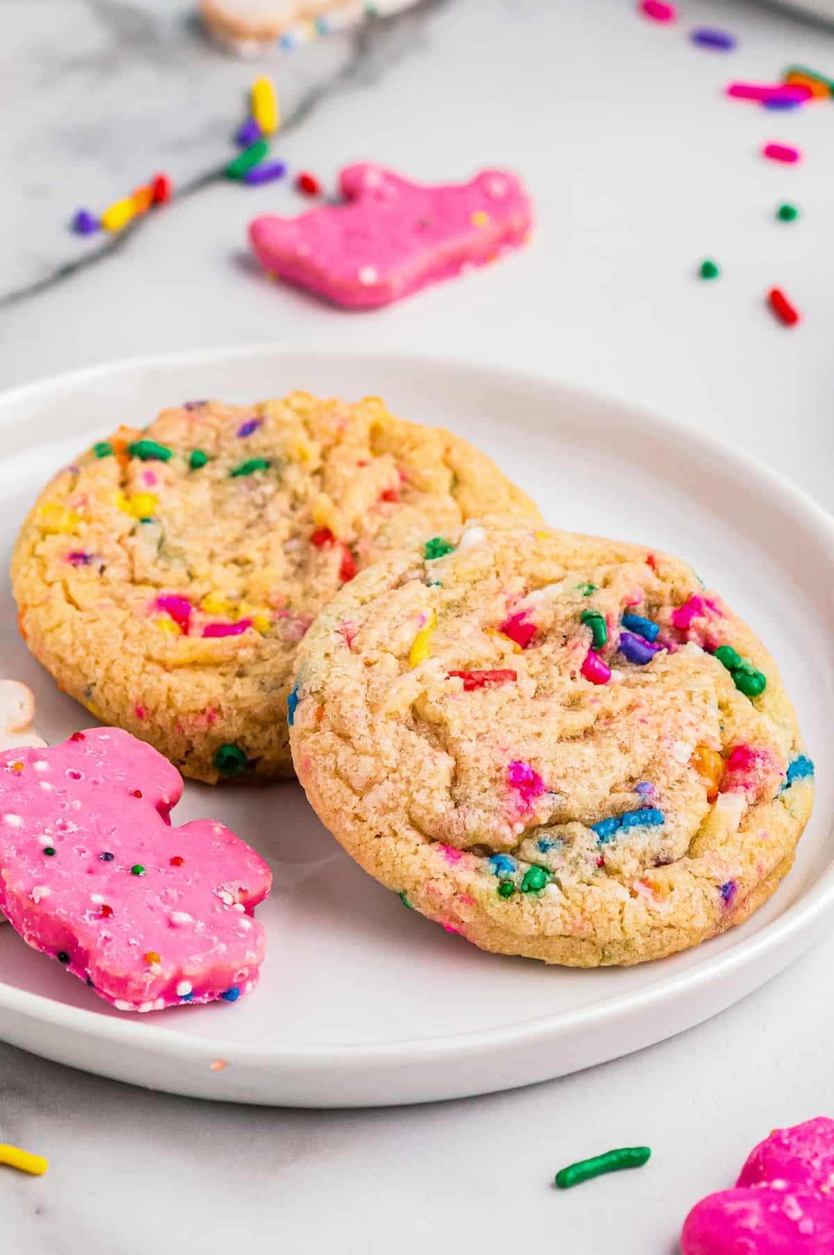 circus animal sugar cookies on white plate