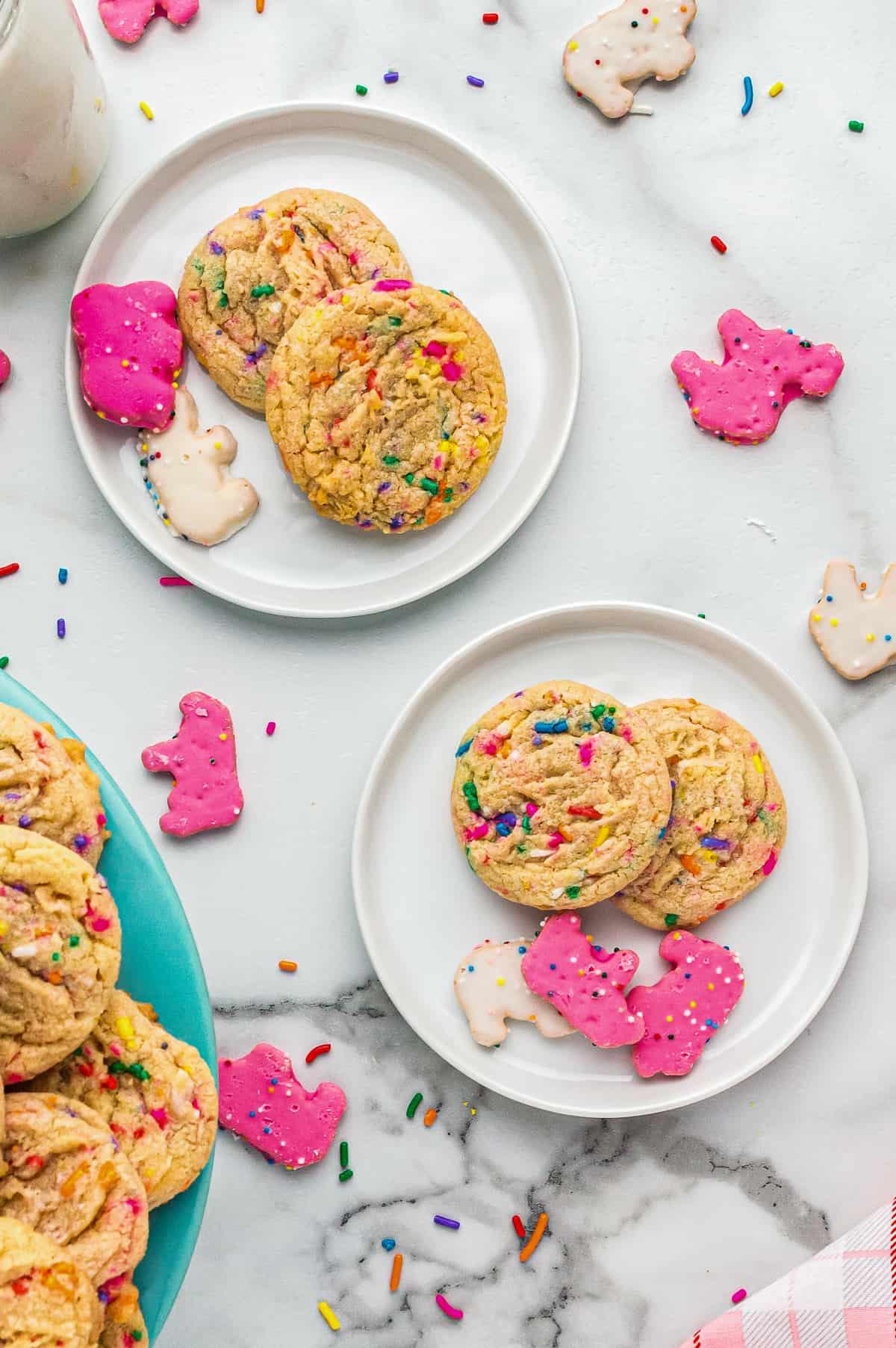 circus animal sugar cookies on white plates