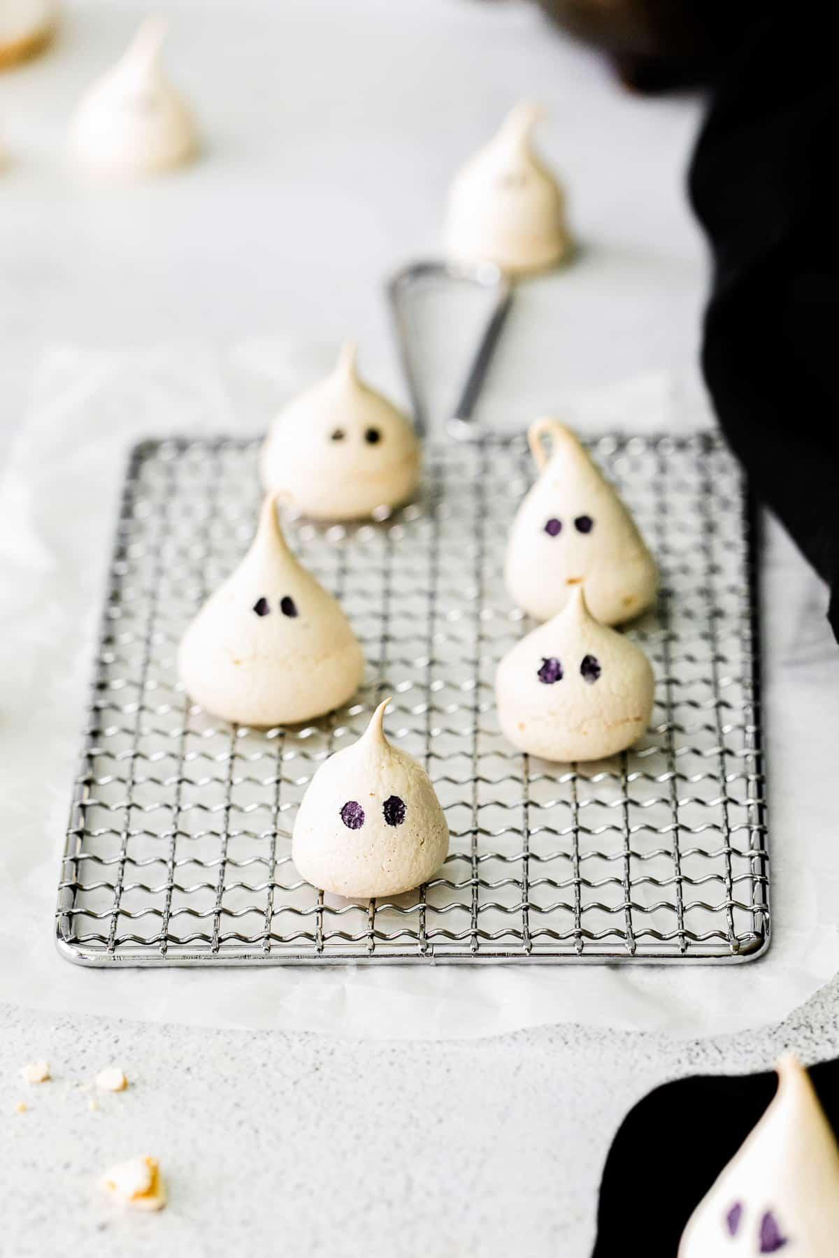 vanilla ghost meringues on cooling rack