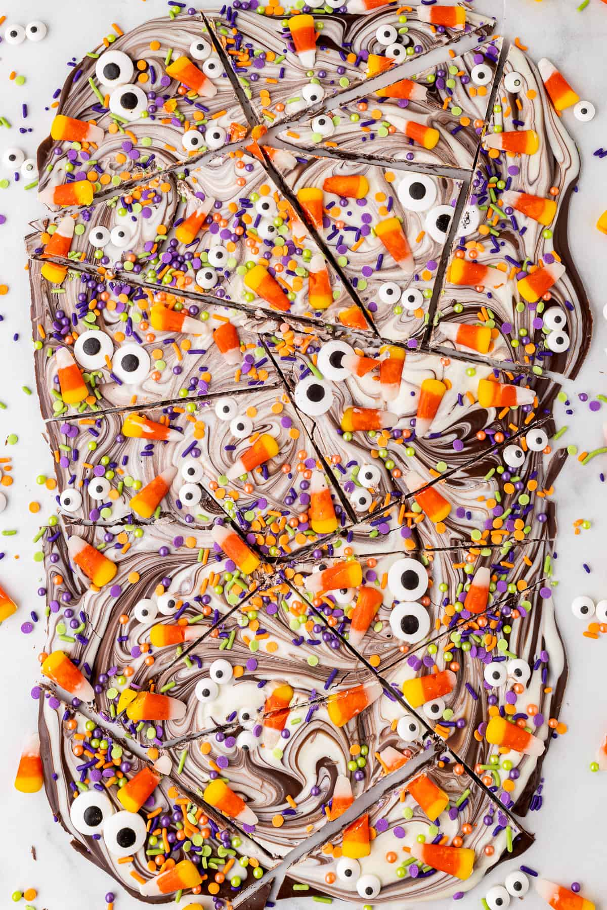 halloween chocolate bark with monster eyes broken apart