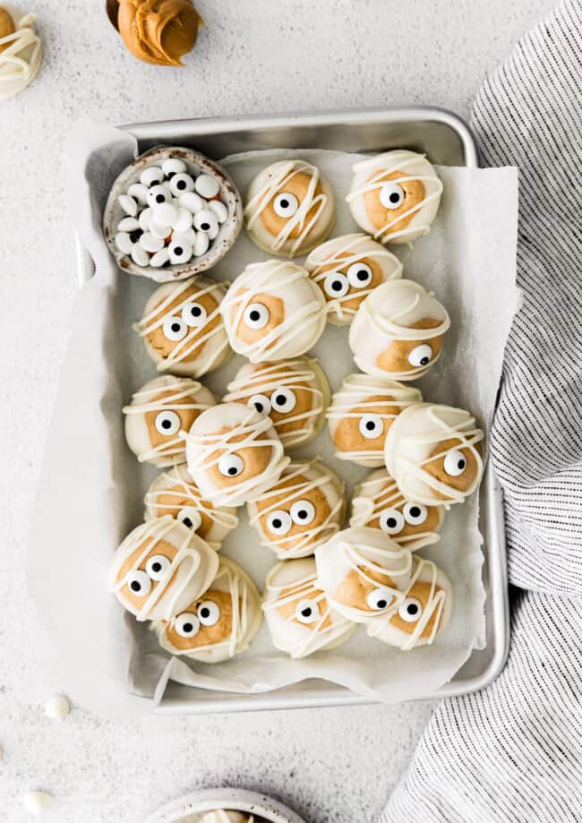 silver tray with white chocolate halloween buckeyes