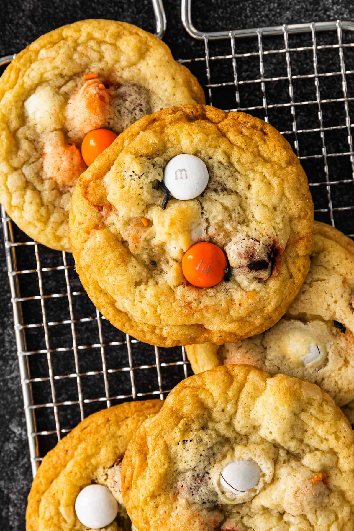 up close halloween m&m cookies on cooling rack