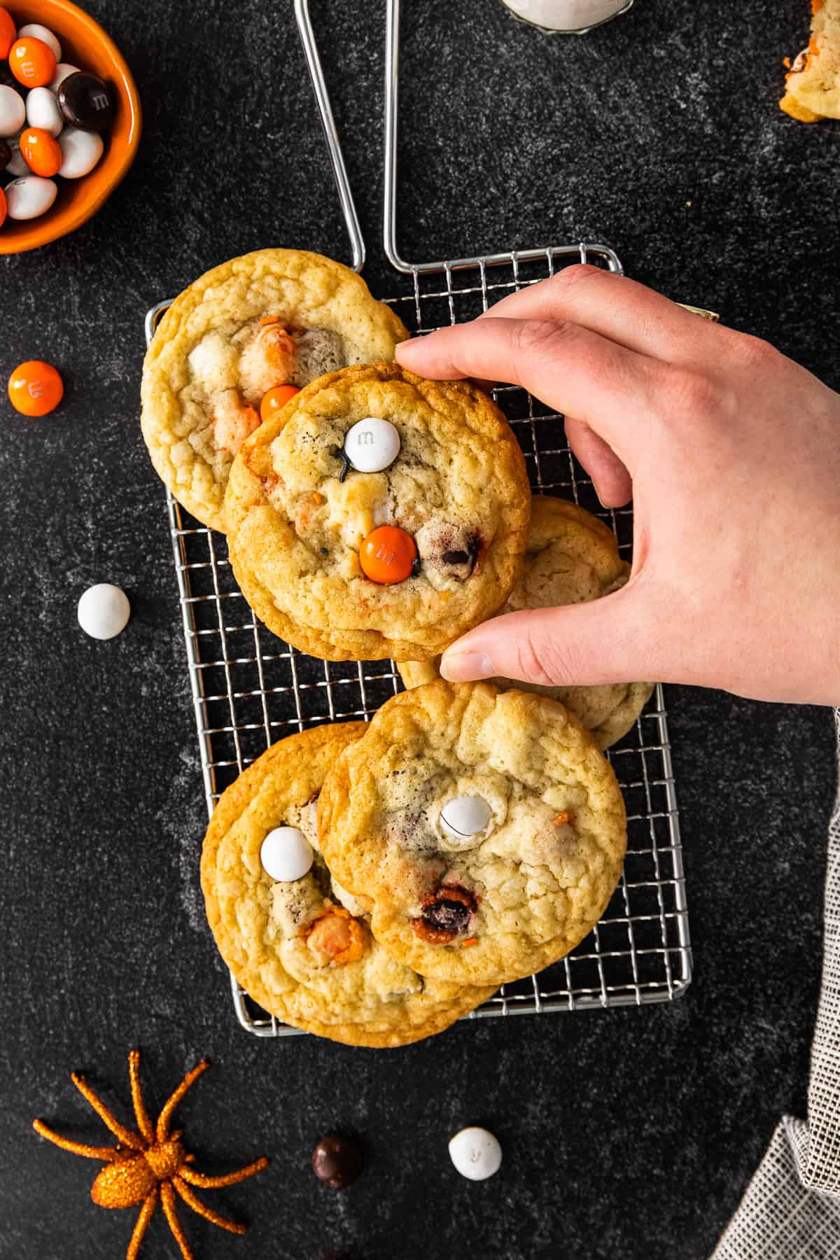 lifting up m&m cookie off of cooling rack