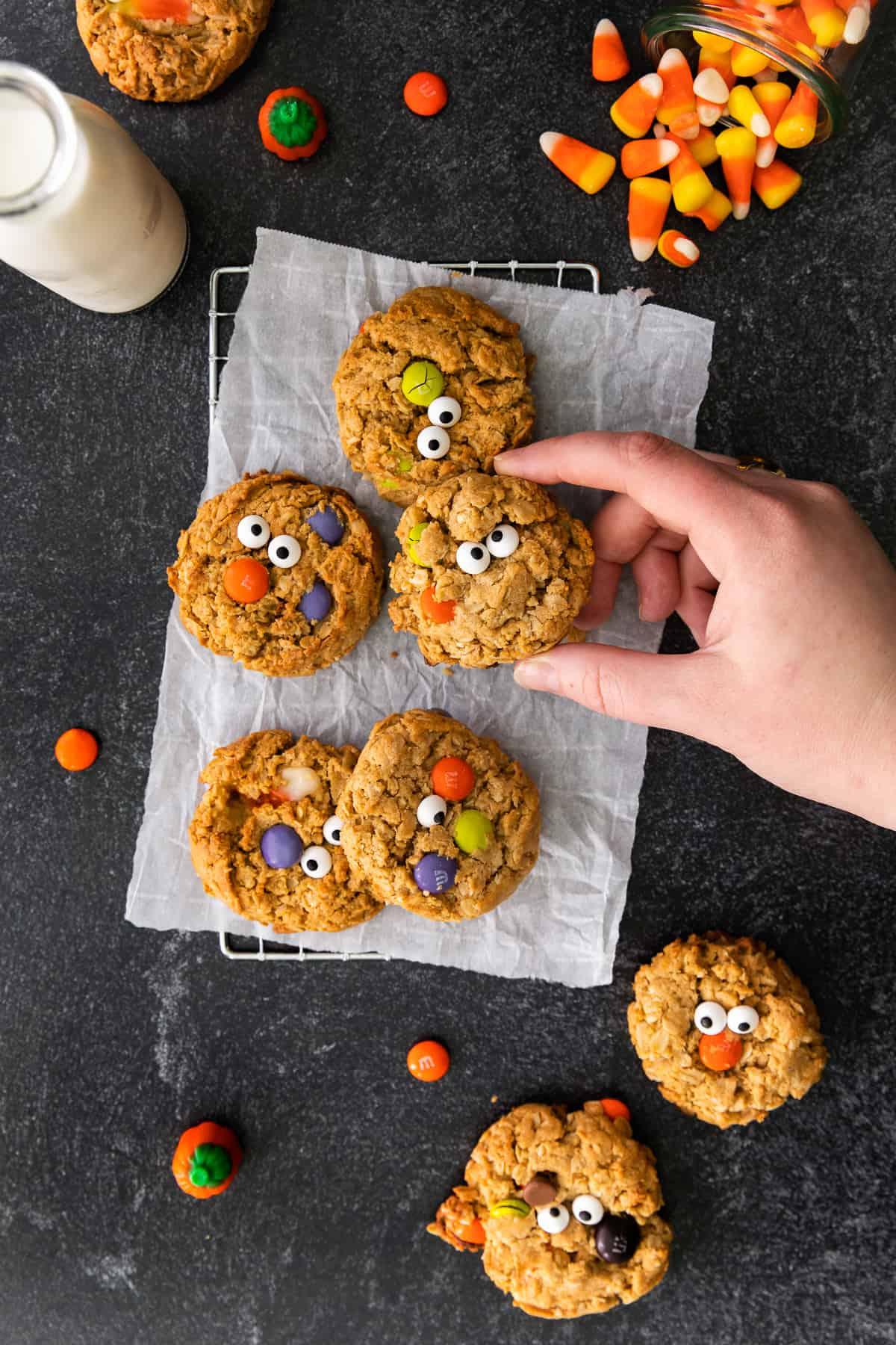 halloween monster cookies on cooling rack