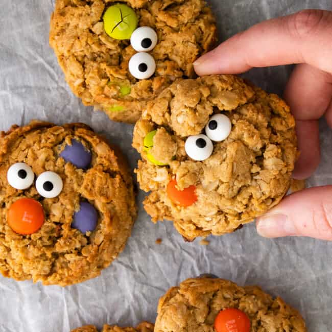 up close halloween monster cookies on parchment