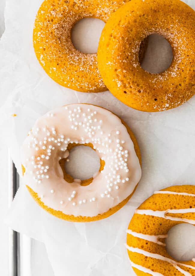 up close baked pumpkin donuts with sprinkles