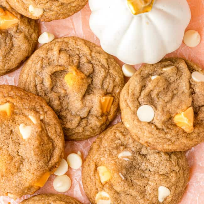 white chocolate pumpkin spice cookies on pink table